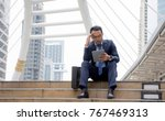 stressed asian businessman are... | Shutterstock . vector #767469313