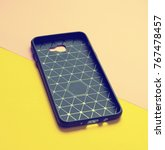 Small photo of Protective cover case for smartphone on a multi-colored paper background.