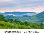 morning fog in tuscany. | Shutterstock . vector #767549563