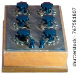 Small photo of Vintage electrotechnical device - Resistors Decade Box. General view isolated on the white background