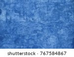 grunge blue faded uneven old... | Shutterstock . vector #767584867