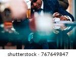 mafioso man playing illegal... | Shutterstock . vector #767649847