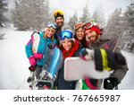smiling friends with ski on... | Shutterstock . vector #767665987