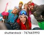smiling friends making selfie... | Shutterstock . vector #767665993