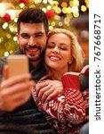 lovely happy couple in warm... | Shutterstock . vector #767668717