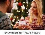 happy woman in love giving... | Shutterstock . vector #767674693