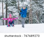 happy boy and girl riding sled... | Shutterstock . vector #767689273