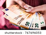 detail of woman hands with euro ... | Shutterstock . vector #767696053