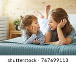 happy family mother and child... | Shutterstock . vector #767699113