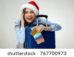 smiling woman wearing christmas ... | Shutterstock . vector #767700973