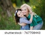 happy mother and daughter...   Shutterstock . vector #767708443