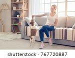 Stock photo young person with dog at home leisure 767720887