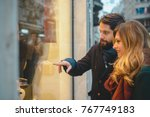 young couple window shopping on ... | Shutterstock . vector #767749183