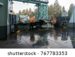 Small photo of Two male Washington State Ferry employees prepare to debark cars