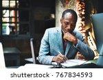 african descent man working    Shutterstock . vector #767834593