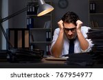 young businessman working... | Shutterstock . vector #767954977