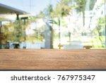 empty wooden table in front of... | Shutterstock . vector #767975347