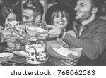 happy people cheering at... | Shutterstock . vector #768062563