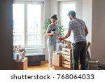 caucasian couple unpacking... | Shutterstock . vector #768064033