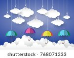 full color umbrella with cloud... | Shutterstock .eps vector #768071233