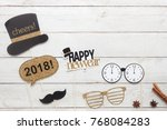 Small photo of Above view aerial image of DIY photo booth props decorations Happy new year 2018 Home party decor background concept.Table top item on modern rustic white wood at home office desk studio & copy space.