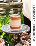 a clay pot on a pottery wheel ... | Shutterstock . vector #768085057