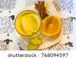 Small photo of Inbred tea with lemon, orange, apple and cinnamon. Vitamin drink in winter. New Year's traditional drink.