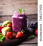 blueberry smoothies on a wooden ... | Shutterstock . vector #768117433