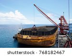 unloading coal in large boat   | Shutterstock . vector #768182467