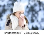 woman blowing in a tissue in a... | Shutterstock . vector #768198037