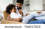 father and daughter watching... | Shutterstock . vector #768317023