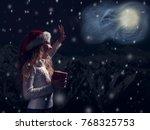 happy child in christmas hat... | Shutterstock . vector #768325753