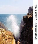 Small photo of Hummanaya water ejection from blue sea through rocks