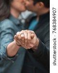 guy and girl kissing holding... | Shutterstock . vector #768384907
