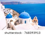 beautiful village of oia with... | Shutterstock . vector #768393913