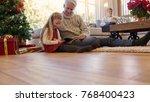 senior man with granddaughter... | Shutterstock . vector #768400423