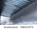 a large amount of snow hangs... | Shutterstock . vector #768412573