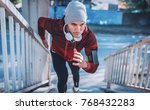 runner. young sportsman running ... | Shutterstock . vector #768432283