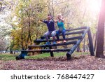 fitness couple stretching... | Shutterstock . vector #768447427