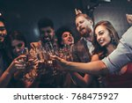 group of friends toasting with... | Shutterstock . vector #768475927