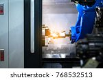 close up robot hands in milling ... | Shutterstock . vector #768532513
