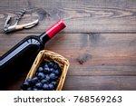 open wine bottle. grape and... | Shutterstock . vector #768569263