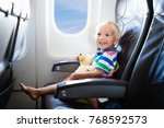 child in airplane. kid in air... | Shutterstock . vector #768592573