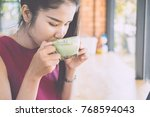 young woman drinking hot green... | Shutterstock . vector #768594043