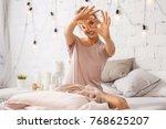 beautiful young woman sitting... | Shutterstock . vector #768625207