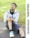 the young man hurt at knee in... | Shutterstock . vector #768629983