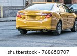 Small photo of Yellow cab in NYC. Taxi along Manhattan street.