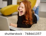 woman having a good laugh while ... | Shutterstock . vector #768661357