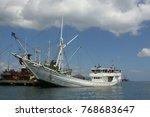 labuhan bajo harbor. flores... | Shutterstock . vector #768683647