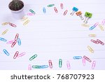 Small photo of Business concept as a group of paperclip on canvas with one individual in the opposite direction.